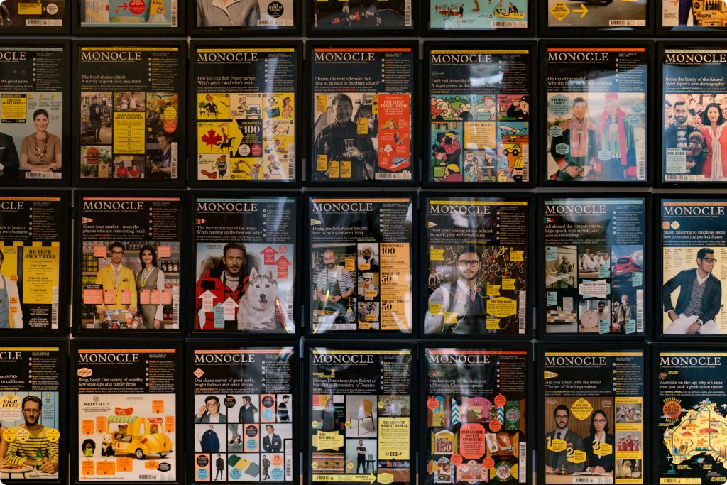 Monocle magazine covers on a wall