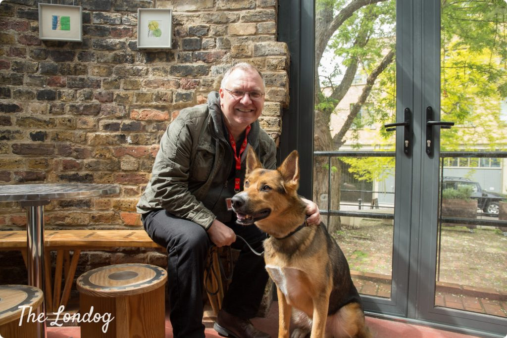 London Walks guide Kevin with dog at the Brunel Museum cafe