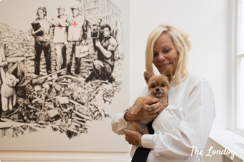 Gallery dog with Banksy painting