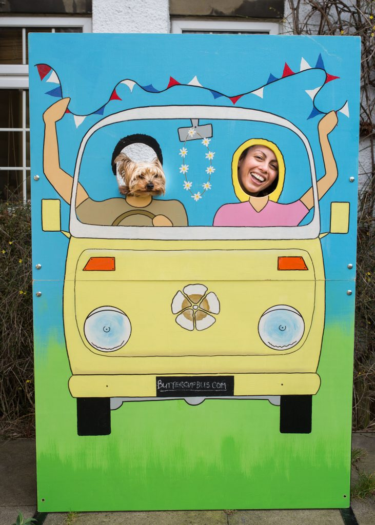 Buttercups campervan photobooth with dog and owner in the face holes