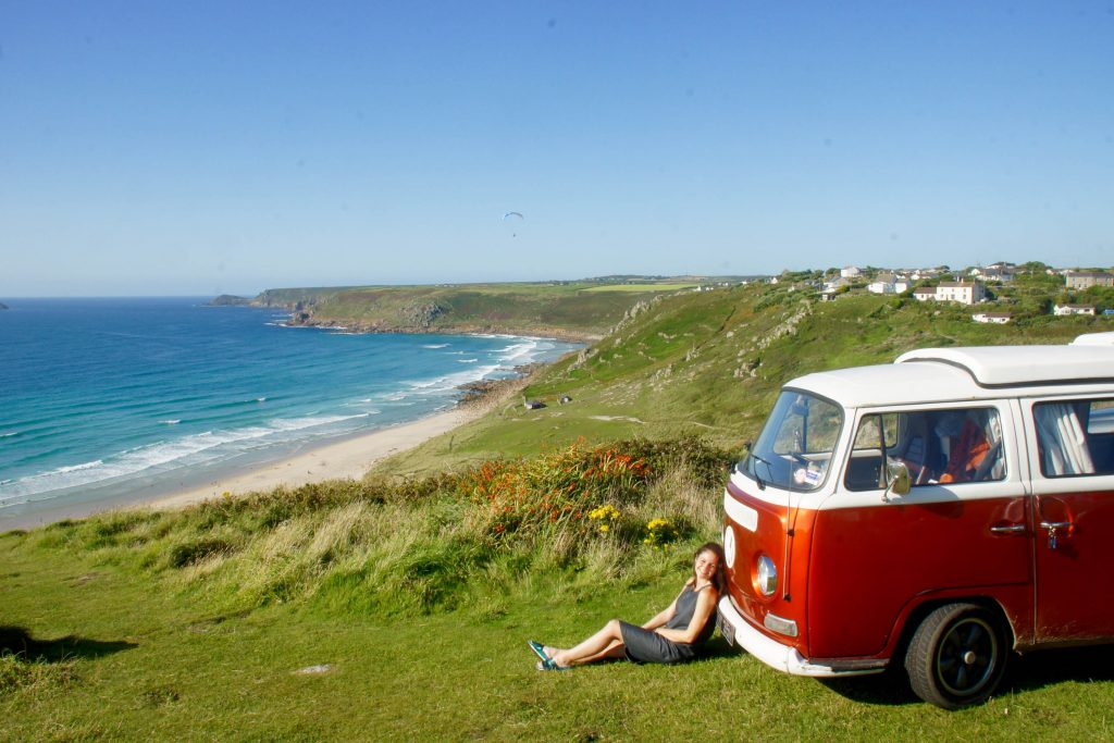 Dub Dub and Away campervan parked near the sea