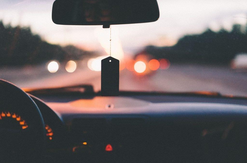 car dashboard at sunset