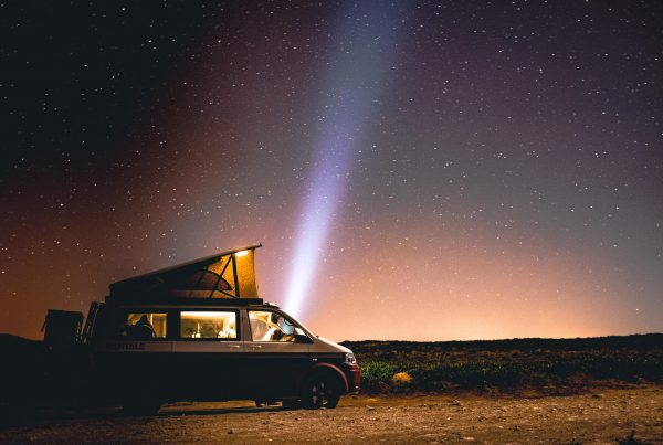 Vintage campervan at night under a starry sky