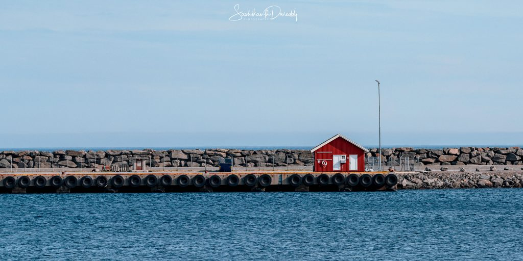 Norwegian red house on the sea