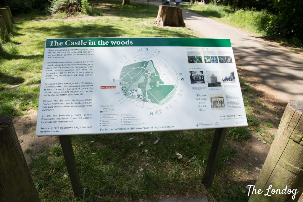 Sign about the castle in the woods