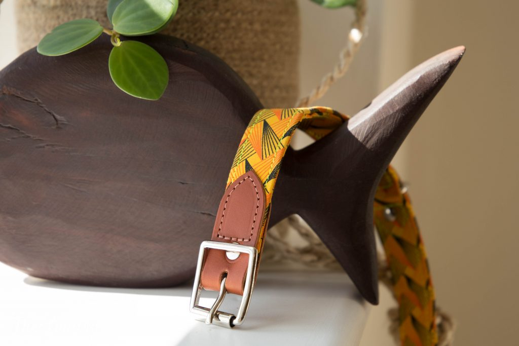 Detail of handmade dog collar leather and african fabric